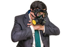 Businessman with gas mask can not breathe bad air. Isolated on white Royalty Free Stock Image