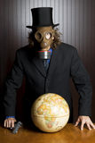 Businessman, gas mask, and earth globe Stock Image
