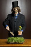 Businessman, gas mask, and flower Stock Photos