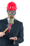 Businessman with gas mask, helmet and hammer Royalty Free Stock Photo
