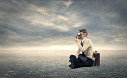 Businessman with a gas mask. Businessman holding on hilmself a gas mask Royalty Free Stock Images