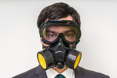 Businessman with gas mask isolated on white. Young businessman with gas mask isolated on white Stock Photos
