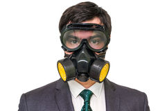 Businessman with gas mask isolated on white. Young businessman with gas mask isolated on white Stock Image
