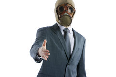 Businessman in a gas mask offering for handshake Royalty Free Stock Images
