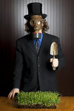 Businessman, gas mask, and potting shovel Royalty Free Stock Image