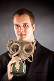 Businessman with gas mask Royalty Free Stock Images