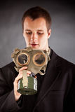 Businessman with gas mask Stock Photo