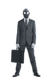 Businessman in a gas mask  with suitcase Stock Photo