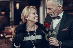 Businessman gave woman rose in Restaurant royalty free stock photography