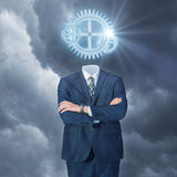 Businessman with gear head. Concept design Stock Photo