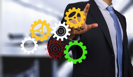 Businessman with gear Royalty Free Stock Photos