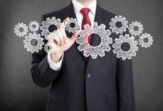 Businessman with gears Stock Images