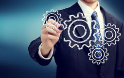 Businessman with gears royalty free stock image