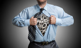 Businessman with gears inside Stock Images