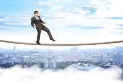 Businessman gently walking on rope Royalty Free Stock Photo