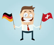 Businessman with german and swiss flag Royalty Free Stock Photos
