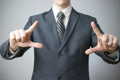 Businessman gesture with his hands Royalty Free Stock Photos