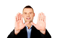 Businessman gesture stop sign with his hands Stock Photo
