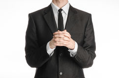 Businessman and gesture topic: a man in a black suit with a tie folded his hands in front of him and praying, meditating businessm Stock Photo