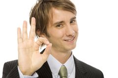 Businessman gestures ok. Businessman in a suit gestures ok with his fingers Royalty Free Stock Photos