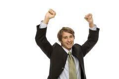 Businessman gestures success. Businessman in a suite raises his arms with triumph Stock Photo