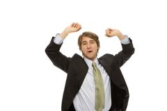 Businessman gestures success. Businessman in a suit gestures triumph with his arms Stock Image