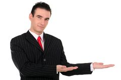 Businessman gesturing. Handsome young businessman gesturing, standing over white background Royalty Free Stock Photos