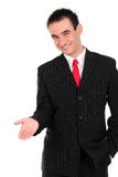 Businessman gesturing. Handsome young businessman gesturing, standing over white background Stock Photos