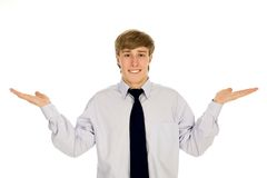 Businessman gesturing. Young businessman gesturing and smiling Royalty Free Stock Image