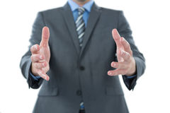 Businessman gesturing against white background Stock Photos