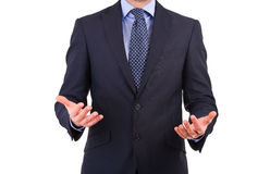 Businessman gesturing with both hands. Stock Image