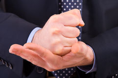Businessman gesturing with both hands. Royalty Free Stock Photography