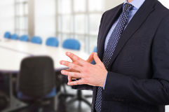 Businessman gesturing with both hands. Royalty Free Stock Images
