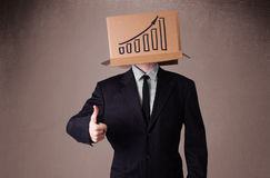 Businessman gesturing with a cardboard box on his head with diag Stock Images