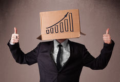 Businessman gesturing with a cardboard box on his head with diag Stock Photo