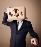 Businessman gesturing with a cardboard box on his head with doll Stock Images
