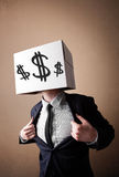 Businessman gesturing with a cardboard box on his head with doll Stock Photography