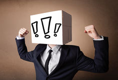 Businessman gesturing with a cardboard box on his head with excl Stock Photography