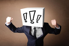 Businessman gesturing with a cardboard box on his head with excl Stock Image