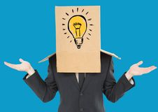 Businessman gesturing with a cardboard box on his head with light bulb Stock Photography