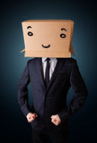 Businessman gesturing with a cardboard box on his head with smil Royalty Free Stock Photos