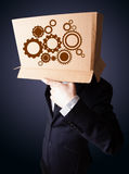 Businessman gesturing with a cardboard box on his head with spur Royalty Free Stock Photography