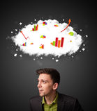 Businessman gesturing with cloud and charts concept Stock Images