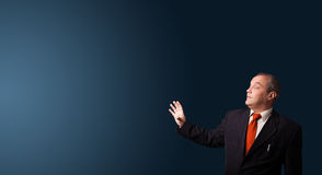 Businessman gesturing with copy space Royalty Free Stock Photos