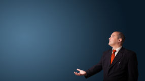 Businessman gesturing with copy space Stock Photo