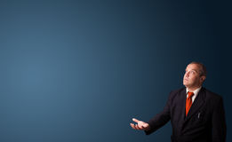 Businessman gesturing with copy space Stock Photos