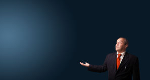 Businessman gesturing with copy space Stock Image