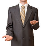 Businessman gesturing with empty up and down hands Stock Image