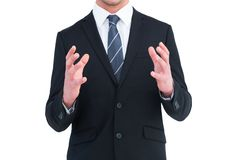 Businessman gesturing with his hands Stock Photography