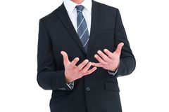 Businessman gesturing with his hands Royalty Free Stock Photography
